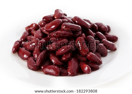 Red beans served in a little  white bowl  - stock photo