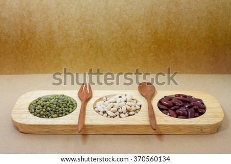 red beans, soy beans, and green beans in wood tray - stock photo