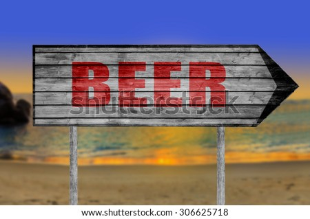 Red Beer wooden sign with on a beach background