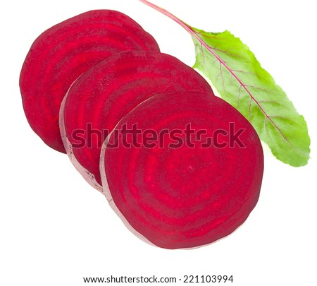 Red beet slices with leafs on white background  - stock photo
