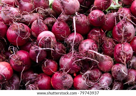 Red beets on display at the farmer's market
