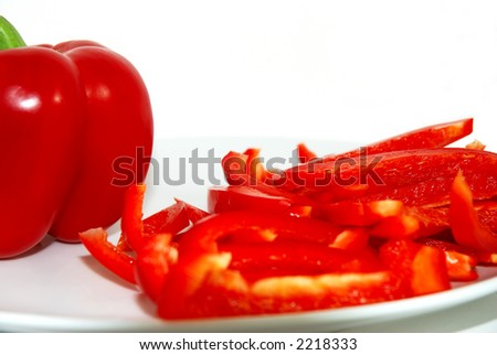 Red bell pepper and slices, isolated on white background. - stock photo
