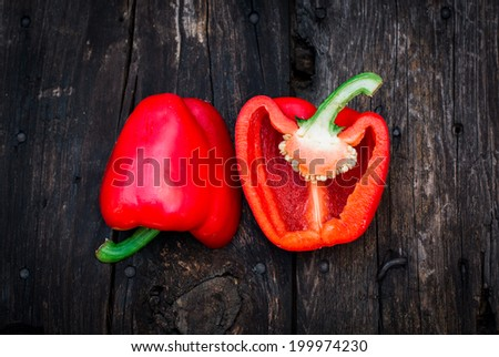 Red bell pepper on the old wooden planks - stock photo