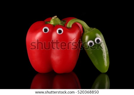 Red bell pepper with friendly chilli , humorous pose.