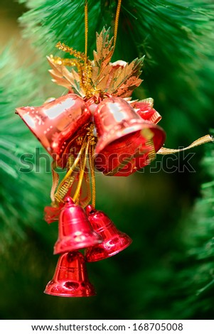 red bells decorations on Christmas tree. new year - stock photo