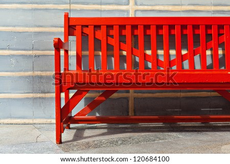 Red Bench Against brick wall - stock photo