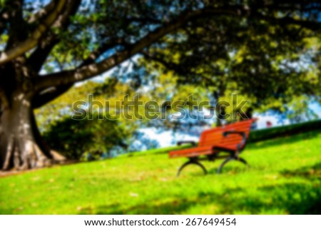 Red bench in the park in Blur style