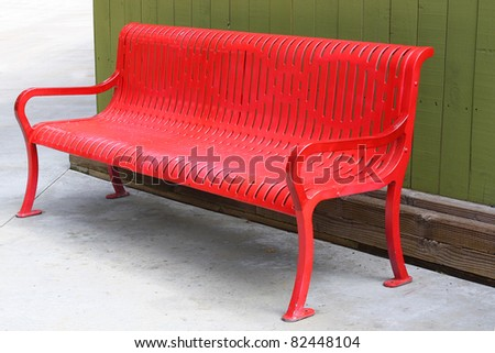 Red Bench on Green Wall