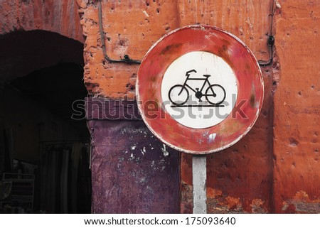 Red bicycle sign on a pole, Marrakech town centre, Morocco - stock photo