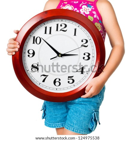 red big clock in girl's hadns - stock photo