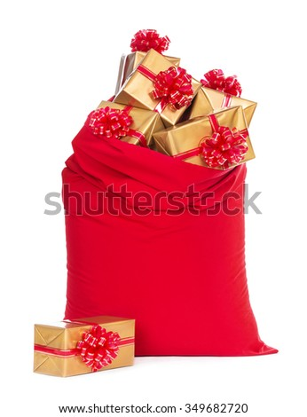 Red big Santa Christmas sack full of and surrounded by golden wrapped gift boxes with bows isolated on a white background