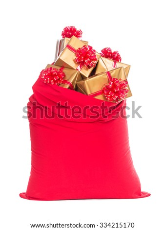 Red big Santa Christmas sack full of golden wrapped gift boxes with bows isolated on a white background