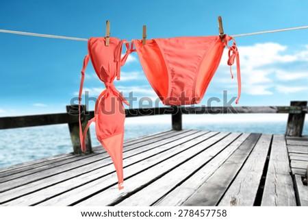 red bikini on rope  - stock photo