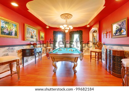 Red billiard luxury room with play pool and cherry hardwood. - stock photo