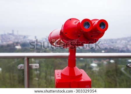 red binoculars for viewing - stock photo