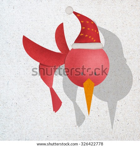 Red bird in action, recycled paper craft stick on white background, Santa , christmas,  merry christmas text,  happy holidays,  christmas tree - stock photo