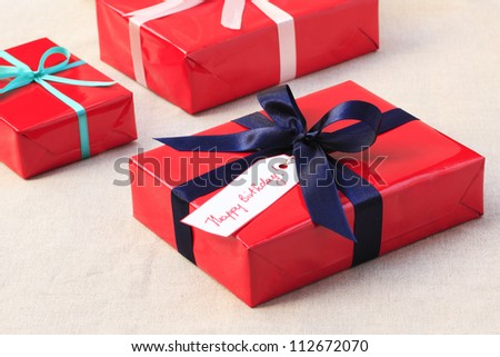 Red Birthday (christmas) presents with blue ribbon - stock photo