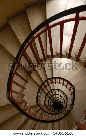 red black and white colored spiral staircase