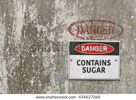red, black and white Danger, Contains Sugar warning sign - stock photo