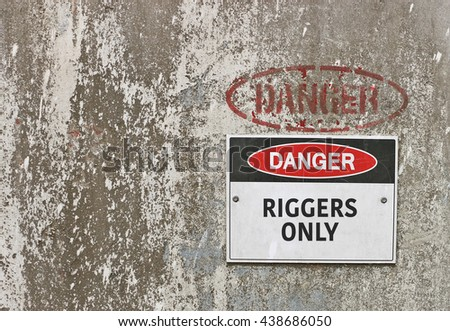 red, black and white Danger, Riggers Only warning sign - stock photo