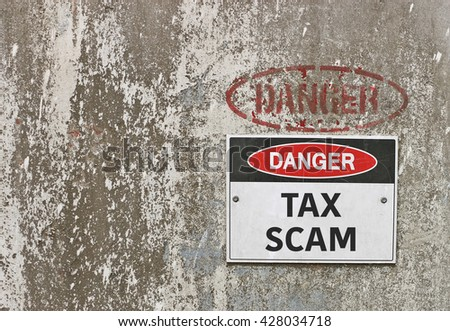 red, black and white Danger, Tax Scam warning sign - stock photo