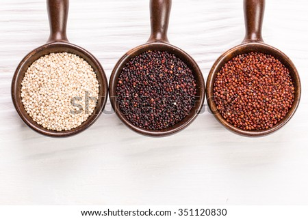 Red, black and white quinoa seeds,healhy food - stock photo