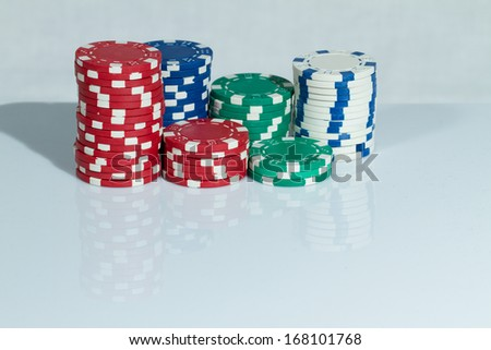 Red, blue, green and white Playing Poker Chips