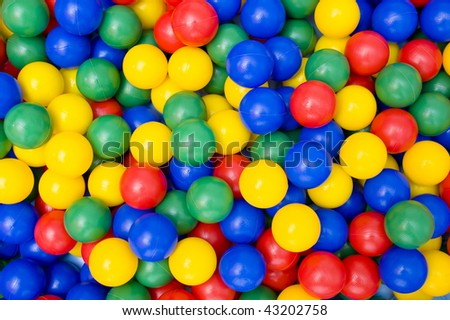 Red, Blue, Green and Yellow colors Balls Background.