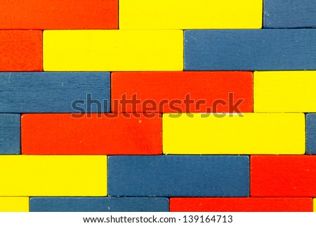 Red, Blue, Yellow Wooden toy blocks as a background
