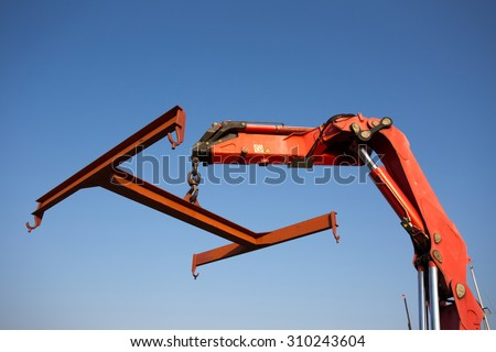 Red boat elevator in marine against blue sky - stock photo