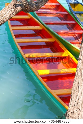 Red boats on the jungle river