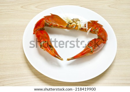 red boiled crabs on a dish at the table - stock photo