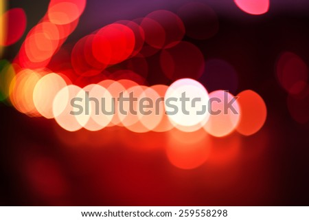 Red bokeh color abstract background with defocused lights - stock photo