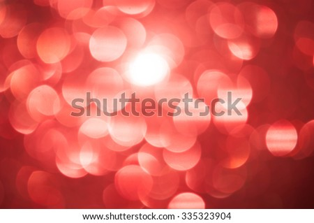Red bokeh Glittering holiday textured Christmas background