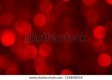 Red bokeh on a dark background - stock photo