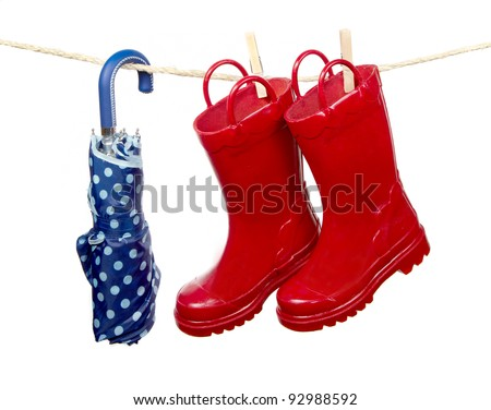 Red Boots and Umbrella - stock photo