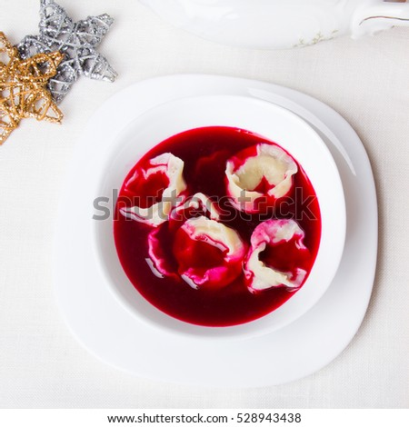 Red borsch with dumplings, traditional Polish Christmas Eve dish