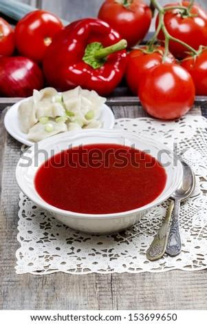 Red borscht with dumplings. Traditional polish cuisine. Selective focus - stock photo