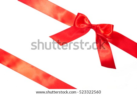 Red bow and diagonal ribbons with tails isolated on white background
