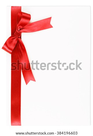 Red bow on a satin ribbon on a white background