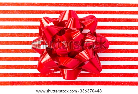 Red bow on striped background - stock photo