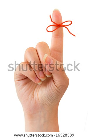 Red bow on woman girl finger isolated on white background - stock photo