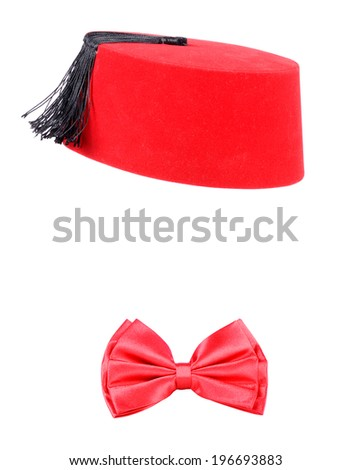 Red bow tie and traditional fez or tarboosh from Morocco isolated on a white background