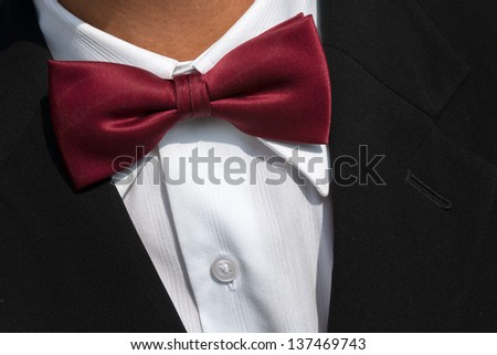 Red Bow tie on white shirt and black suit