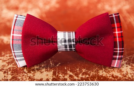 red bow tie with a black pattern - stock photo