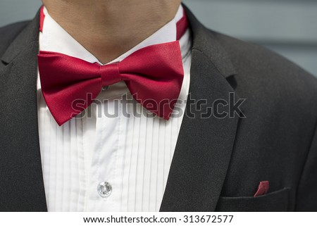 Red bow tie with black shirt closeup