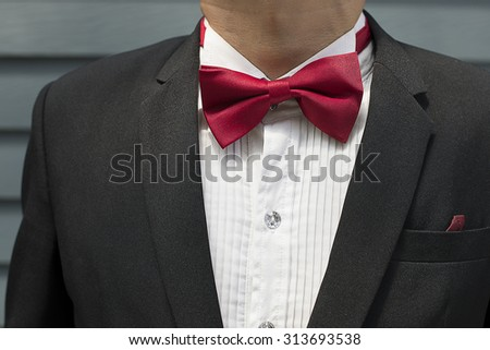 Red bow tie with black shirt closeup - stock photo