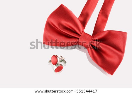 red bow tie  with cuff links on white background