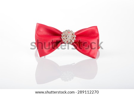 red bow tie with sequins on a white background - stock photo