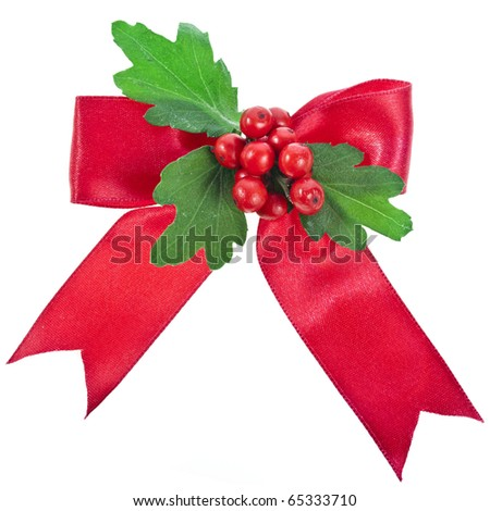 red bow with christmas berries isolated on white - stock photo
